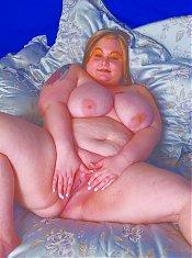 Fat redhead spreading her pink vulva