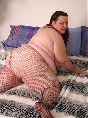 Gorgeous bbw Anne showing off her massive knockers and taking a big cock in her chubby cooze