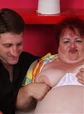 Chunky redhead Margaret flashes her big boobs and attracts a handsome guy with a revved up meat