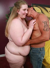 Jessie spreads her thick thighs wide to let this hunk examine her huge fat covered mound