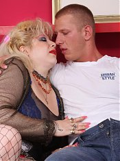 Busty blonde BBW Zhanna flaunts her huge tits and later rides a cock after giving it a mouthfuck